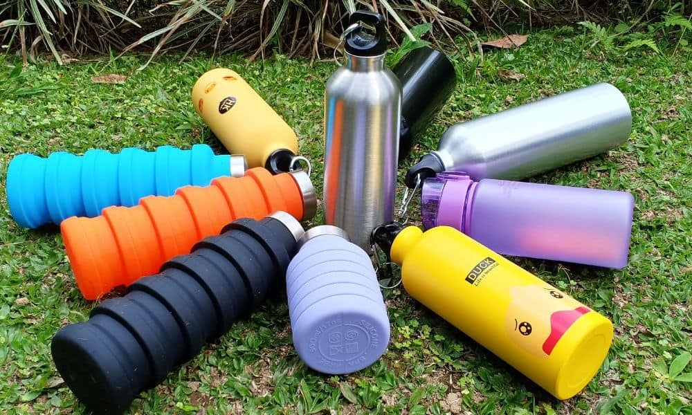 stainless steel bottle water on the grass